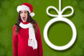 Composite image of stressed brunette in santa hat screaming  — Stock Photo