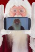 Santa records himself with smartphone — Stock Photo