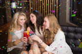 Pretty friends drinking cocktails together — Photo