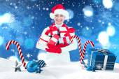 Festive woman holding gifts — Stock Photo