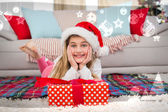Girl smiling at camera with gift — Stock Photo