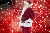 Santa Claus shows his side to camera — Stock Photo