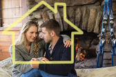 Romantic couple in front of lit fireplace — Stock Photo