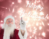Santa writes something with pen — Stock Photo
