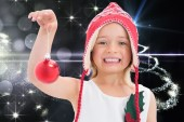 Composite image of cute girl showing bauble — Stock Photo