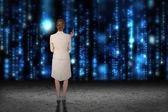 Businesswoman against blue shimmering matrix — Stock Photo