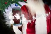 Santa claus showing smartphone — Stock fotografie