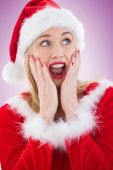 Festive blonde with hands on face — Stock Photo