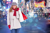 Blonde in winter clothes with bags — Stock Photo