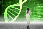 Thinking businesswoman against dna helix — Stock Photo