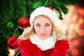 Festive blonde against christmas decorations — Stock Photo