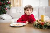 Festive boy having milk and cookies — Stock Photo