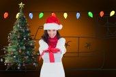 Brunette in santa hat giving gift — Foto de Stock