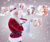 Father christmas writes a list — Stock Photo