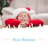 Festive little boy smiling at camera — Stock Photo