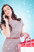 Brunette with shopping bags on phone — Foto de Stock