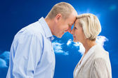 Happy mature couple facing each other — Stock Photo