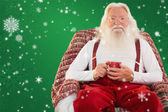 Father christmas sitting on armchair — Stock Photo