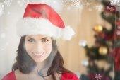 Composite image of festive brunette posing at christmas — Stock Photo