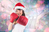 Festive brunette punching with boxing gloves — Stock Photo