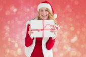 Pretty blonde in warm clothing holding a gift — Stock Photo