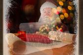 Santa claus reads a list — Stock Photo
