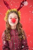 Kleine meisje dragen rode neus — Stockfoto