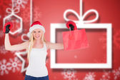 Composite image of festive blonde cheering with boxing gloves — Stock Photo