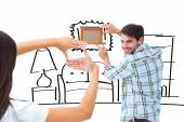 Couple putting up picture frame — 图库照片