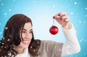 Pretty brunette holding bauble — Stock Photo