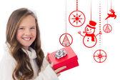 Composite image of girl holding gift — Stockfoto