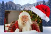 Santa claus writing his list with a quill — Stok fotoğraf