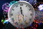 Composite image of clock counting to midnight — Stock Photo