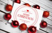 Composite image of banner and logo saying merry christmas — Stock Photo