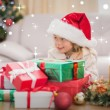 Girl surrounded by christmas gifts — Stock Photo #62500069