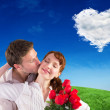 Woman getting roses from man — Stock Photo #62500435