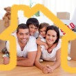 Happy family after buying new house — Stock Photo #62500883