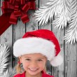 Composite image of cute little girl wearing santa hat — Stock Photo #62501053