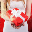 Woman holding red and white gift — ストック写真 #62501109