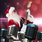 Santa playing electric guitar — Stock Photo #62501207