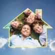 Happy family lying on the grass in a circle — Stock Photo #62501511
