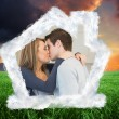 Composite image of hugging and kissing couple — Stock Photo #62501517