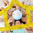 Teenagers on the floor with a terrestrial globe — Stockfoto #62501535