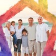 Composite image of beautiful family at the beach — Stock Photo #62501847