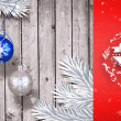 Christmas baubles hanging over wood — Stock Photo #62502335