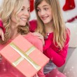 Little girl giving her mother a christmas gift — Stock Photo #62502413