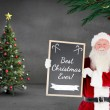 Santa claus showing blackboard — Stock Photo #62502419