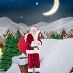 Santa on cottage roof — Stock Photo #62503131