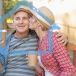 Happy mature couple drinking coffee on a bench — Stock Photo #62503173