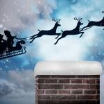 Santa flying against twinkling stars — Stock Photo #62503649